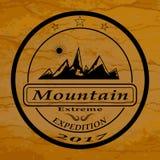 El logotipo de la expedición de la montaña Fotografía de archivo libre de regalías