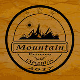 El logotipo de la expedición de la montaña Fotografía de archivo