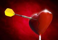 El lollipop en forma de corazón quebrado golpeó por una flecha Imagen de archivo libre de regalías