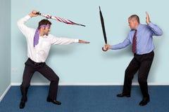 El luchar de dos hombres de negocios Foto de archivo libre de regalías