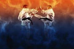 El luchar masculino del karate dos fotos de archivo libres de regalías