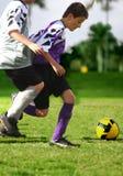El luchar para el balón de fútbol Imagen de archivo libre de regalías