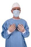 El médico serio cirujano funciona aislado Foto de archivo libre de regalías