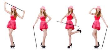 El mago bastante joven en el mini vestido rosado aislado en blanco Foto de archivo libre de regalías
