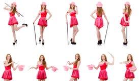 El mago bastante joven en el mini vestido rosado aislado en blanco Fotos de archivo