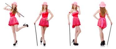 El mago bastante joven en el mini vestido rosado aislado en blanco Imagen de archivo libre de regalías