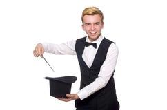 El mago con el palillo mágico aislado en blanco Foto de archivo libre de regalías