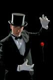 El mago joven con se levantó Foto de archivo