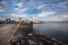 El Malecon famous sea fron promenade in Havana, Cuba. Havana, Cuba - September 22, 2015: Classic american car drive on Havana most popular sea fron promenade, El Royalty Free Stock Image