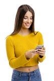 El mandar un SMS a mi amigo Imagen de archivo libre de regalías