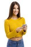 El mandar un SMS a mi amigo Foto de archivo