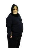 El maniaco en una máscara amenaza con un cuchillo Foto de archivo