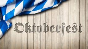 El mantel bávaro en un fondo de madera con tallado redacta Oktoberfest Foto de archivo