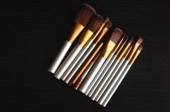 El maquillaje cepilla el oro Imagen de archivo
