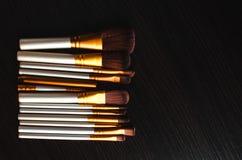 El maquillaje cepilla el oro Imagenes de archivo