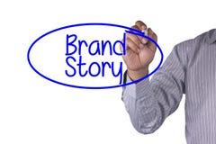 El marcador de la escritura del concepto del negocio y escribe historia de la marca Fotografía de archivo libre de regalías