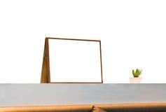 El marco en blanco blanco encendido adorna la barra de pared Imagenes de archivo