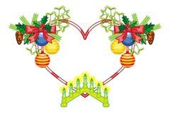 El marco en forma de corazón con las decoraciones de la Navidad y la vela ligera arquean Imagen de archivo