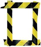 El marco negro amarillo de la muestra del aviso de la cinta amonestadora de la precaución, fondo adhesivo vertical de la etiqueta Fotos de archivo libres de regalías