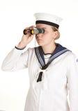 El marinero joven con los prismáticos aisló blanco Foto de archivo