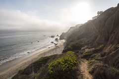 El Matador State Beach Malibu. Sun bursting through afternoon fog bank at El Matador State Beach north of Malibu, California Royalty Free Stock Images