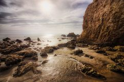 El Matador Tide Pools. Beautiful tide pools and rock formations on a sunny day with clouds in the sky, El Matador State Beach, Malibu, California Royalty Free Stock Images