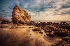 El Matador Tide Pools. Beautiful tide pools and rock formations on a sunny day with clouds in the sky, El Matador State Beach, Malibu, California Royalty Free Stock Image