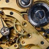 El mecanismo de un reloj viejo Imágenes de archivo libres de regalías