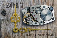 El mecanismo del reloj, flechas de horas y el Año Nuevo Imagenes de archivo