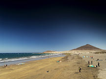 El medano beach and montana roja landscape in tenerife spain Royalty Free Stock Photos