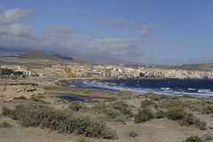 El Medano beach and resort, Tenerife, Canary Islands, Spain. Views towards the town and beaches of El Medano from the base of Montana Roja, a natural reserve Royalty Free Stock Photo