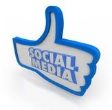 El medio social redacta los pulgares azules encima de la red de la comunidad Fotos de archivo libres de regalías