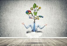 El meditar sin cabeza del hombre de negocios Imagen de archivo libre de regalías