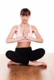 El Meditating en la posición de loto Foto de archivo libre de regalías