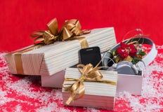 El mejor regalo 2015 del teléfono y de la Navidad de los auriculares Foto de archivo