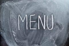El menú de la palabra en una pizarra Fotos de archivo