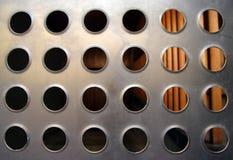 El metal agujerea al detalle urbano Foto de archivo