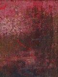 El metal del fondo aherrumbró rojo Foto de archivo libre de regalías