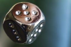 El metal dos corta en cuadritos en el fondo de cristal Foto de archivo libre de regalías