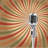 El micrófono retro irradia el fondo Imagen de archivo libre de regalías
