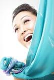 El mirar a escondidas de detrás la seda Imagen de archivo libre de regalías