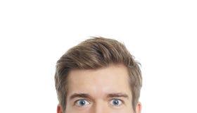 El mirar fijamente de los ojos del varón Fotografía de archivo