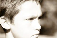 El mirar fijamente del muchacho Foto de archivo libre de regalías