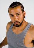 El mirar fijamente masculino del afroamericano la cámara Foto de archivo libre de regalías