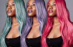 El mismo retrato del ` s de la mujer con diverso color del pelo Imagen de archivo libre de regalías