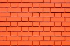 El modelo anaranjado del edificio de ladrillo de la pared coloreado texturizó el fondo Foto de archivo libre de regalías