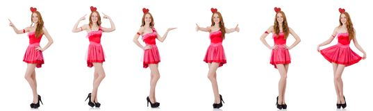 El modelo bastante joven en el mini vestido rosado aislado en blanco Fotografía de archivo