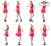 El modelo bastante joven en el mini vestido rosado aislado en blanco Foto de archivo