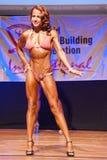 El modelo de la figura femenina muestra su mejor en el campeonato en etapa Fotografía de archivo libre de regalías