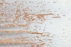 El modelo de madera superficial del primer en el blanco pintó al tablero de madera en el viejo fondo de madera de la textura de l Foto de archivo libre de regalías
